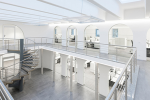 """<div class=""""bildtext"""">Die Büros sind rings um ein Atrium angeordnet.</div>"""